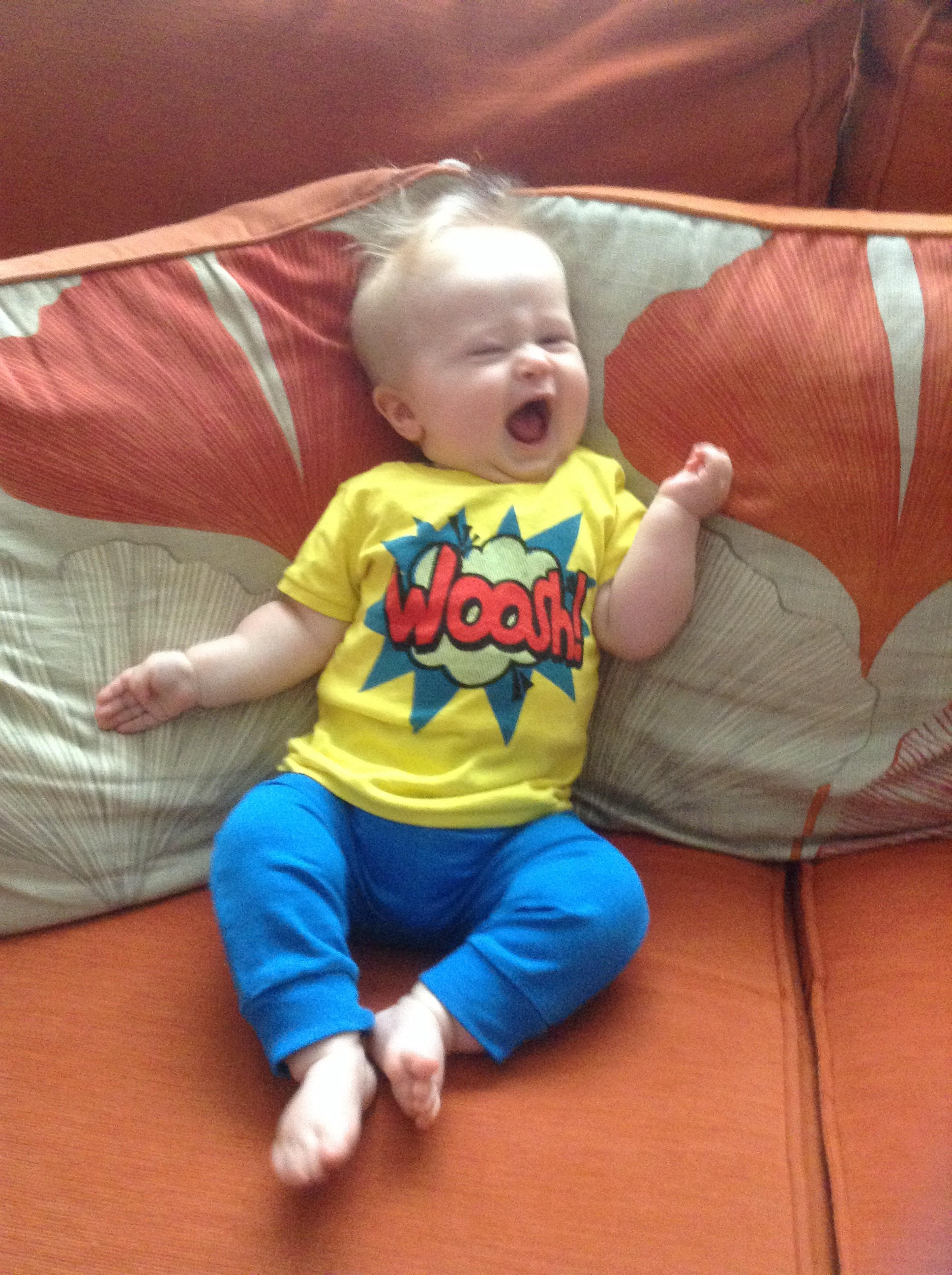 baby fashion, bright blue jogging pants and yellow t shirt with a red woosh in the middle and blue pattern
