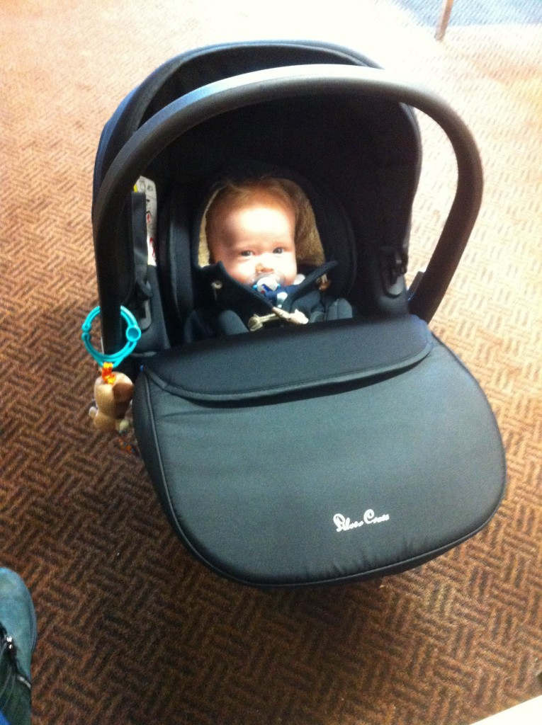 Lucas sat in the silvercross simplicity car seat