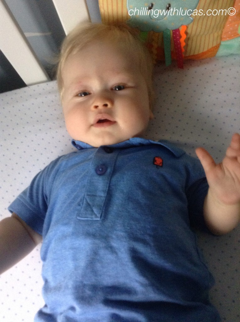 lucas is looking up, led down wearing a blue polo shirt