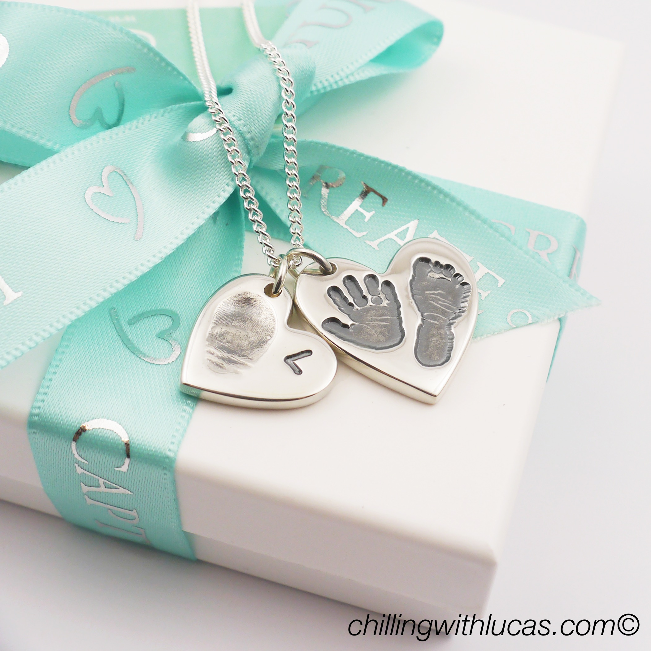 Bella and bow duo of hearts necklace