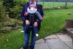 Baby bjorn carrier being worn by me holding Lucas
