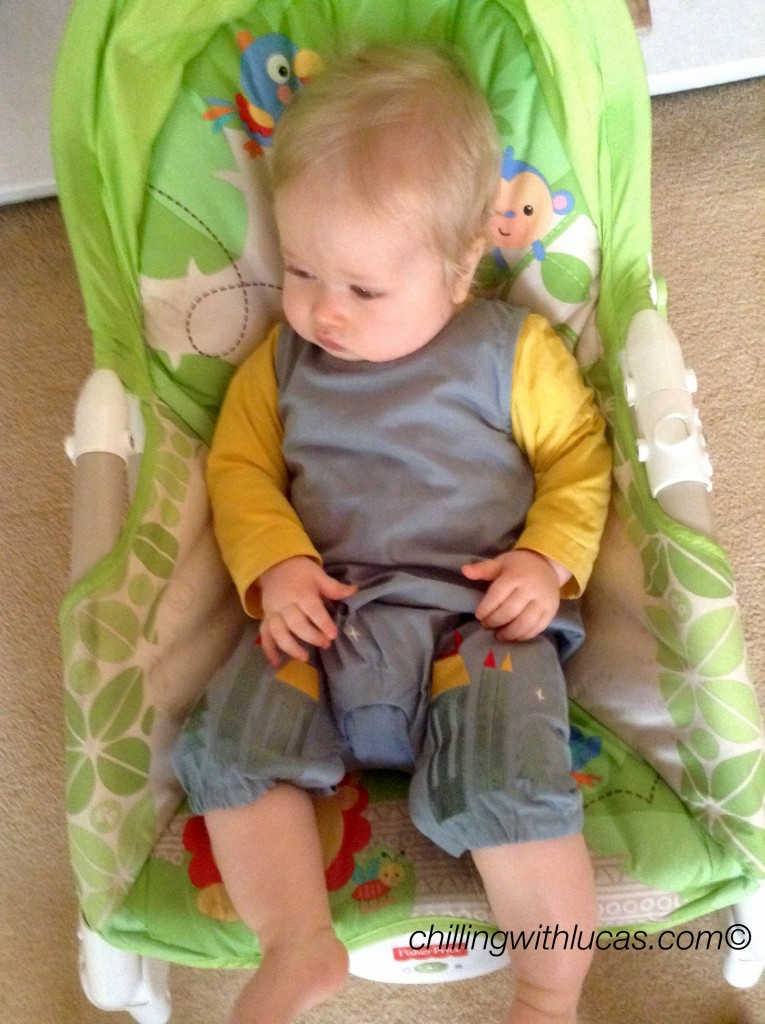 Lucas wearing Little green radicals enchanted castles dunagrees sat in his chair