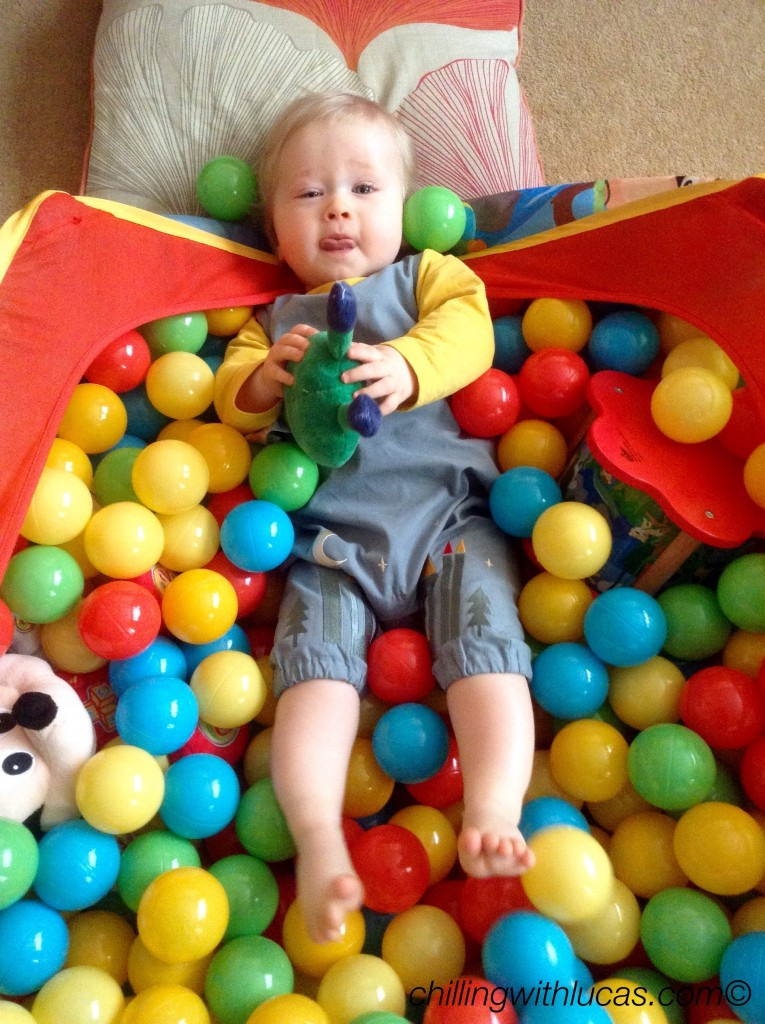 Lucas wearing Little green radicals dungarees in his ball pool