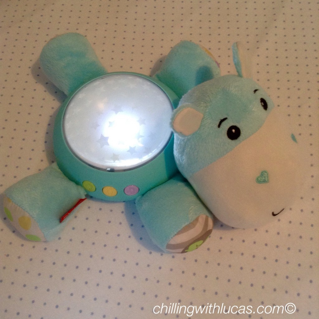 Fisherprice hippo light projection soother in the dark showing it lit up