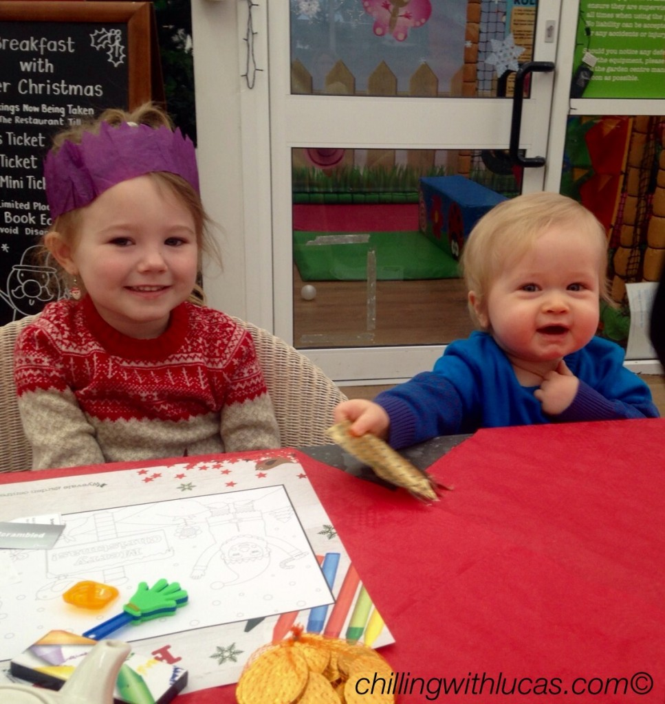 Breakfast with Father Christmas. Lucas as a baby and a 4 year old friend sat next to him