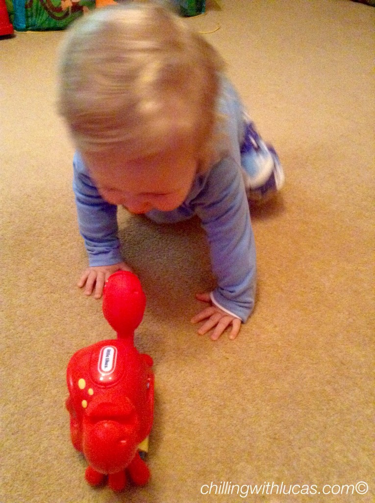 Lucas crawling after the Little tikes catch me crabbie