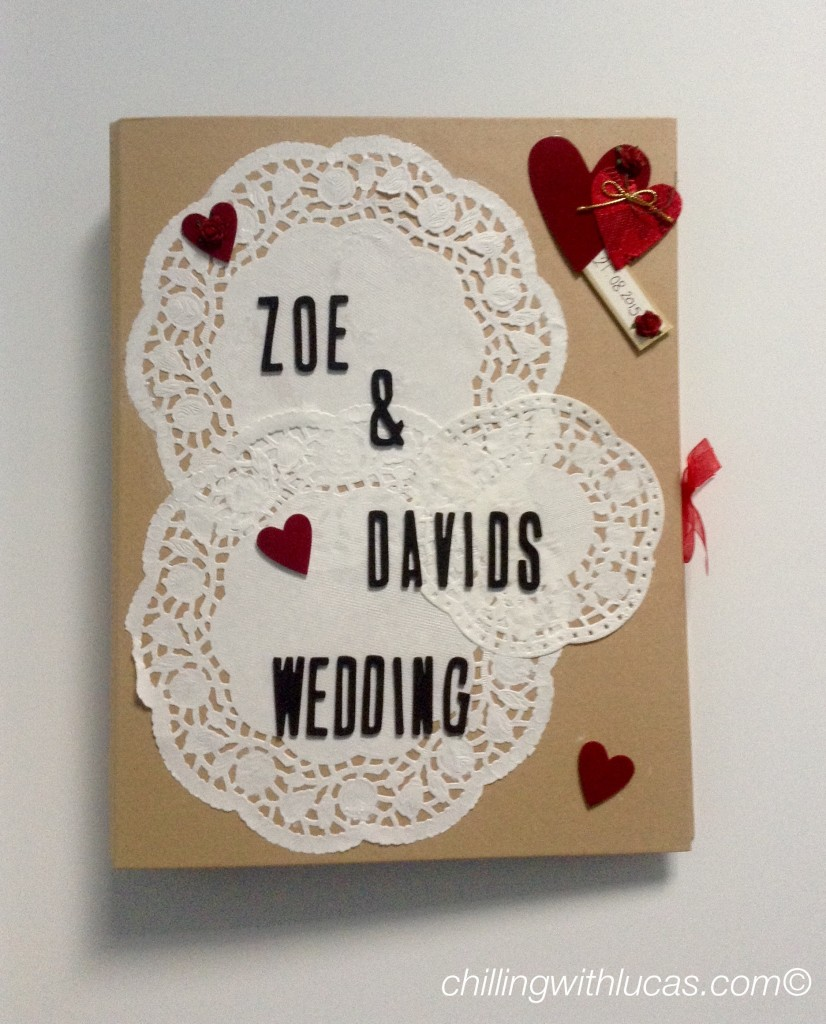 Wedding planner file that i made. it is brown with white doilies and white red hearts