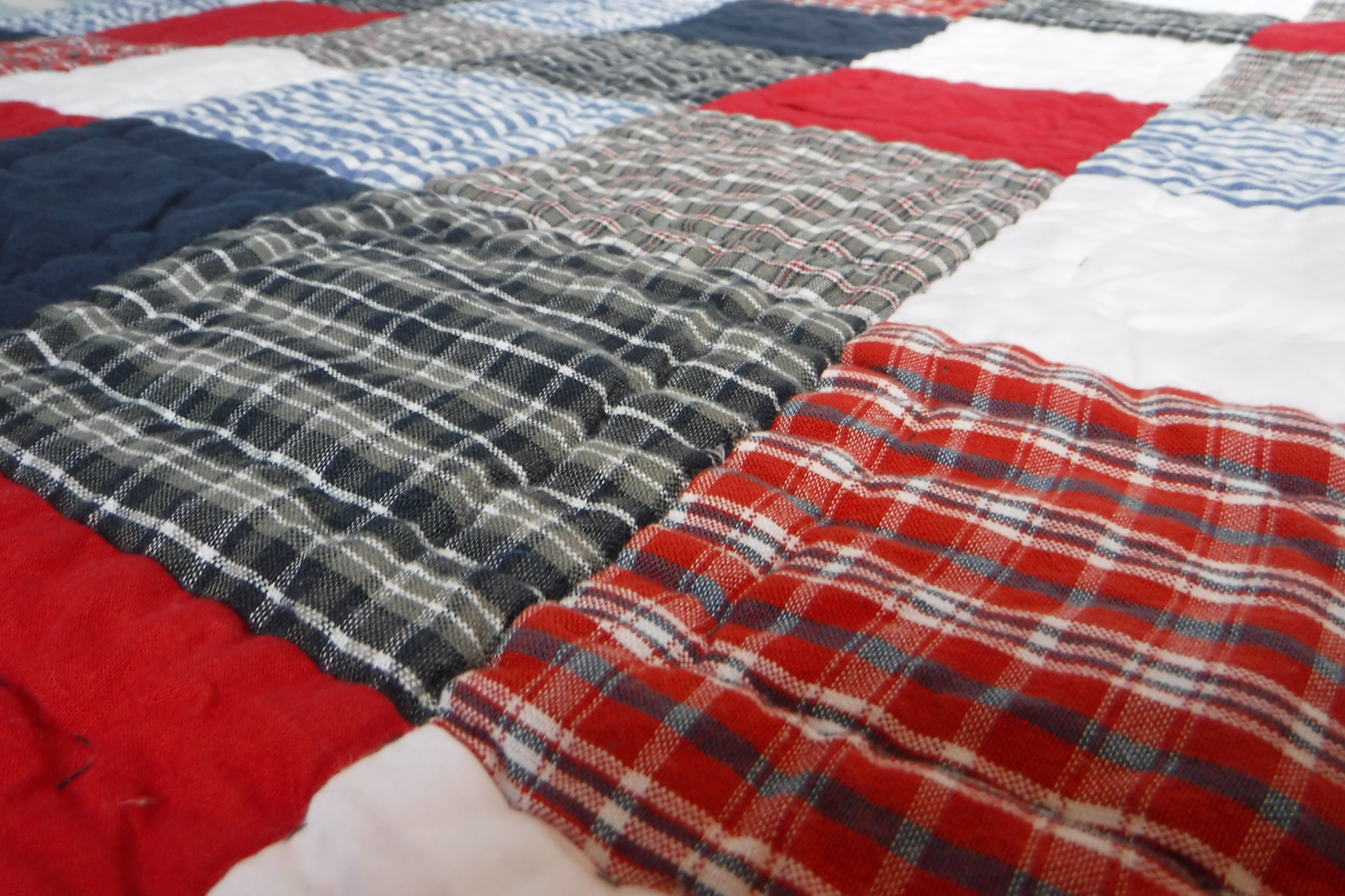 Transitioning from co-sleeping to own bedroom. babyface blue red and white patchwork quilt