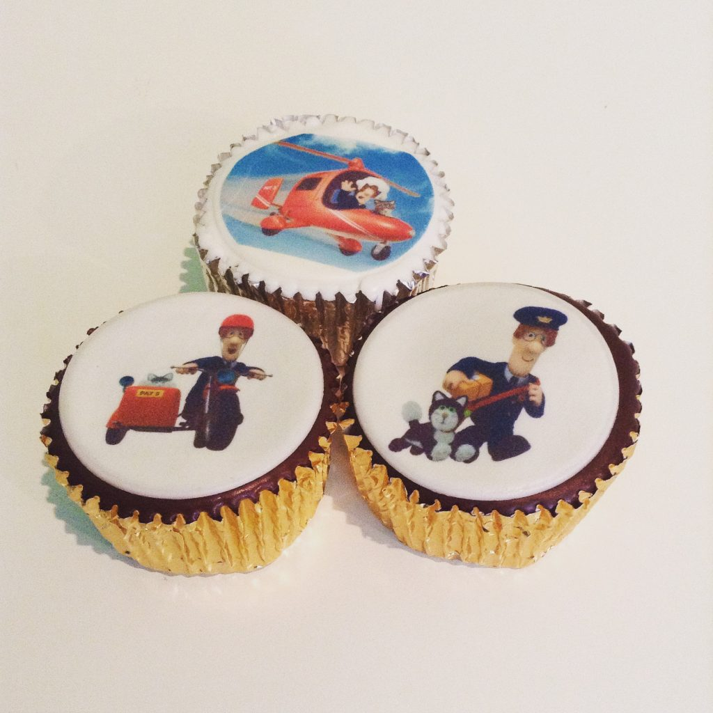 Caketoppers review three cupcakes with postman pat printed on white icing