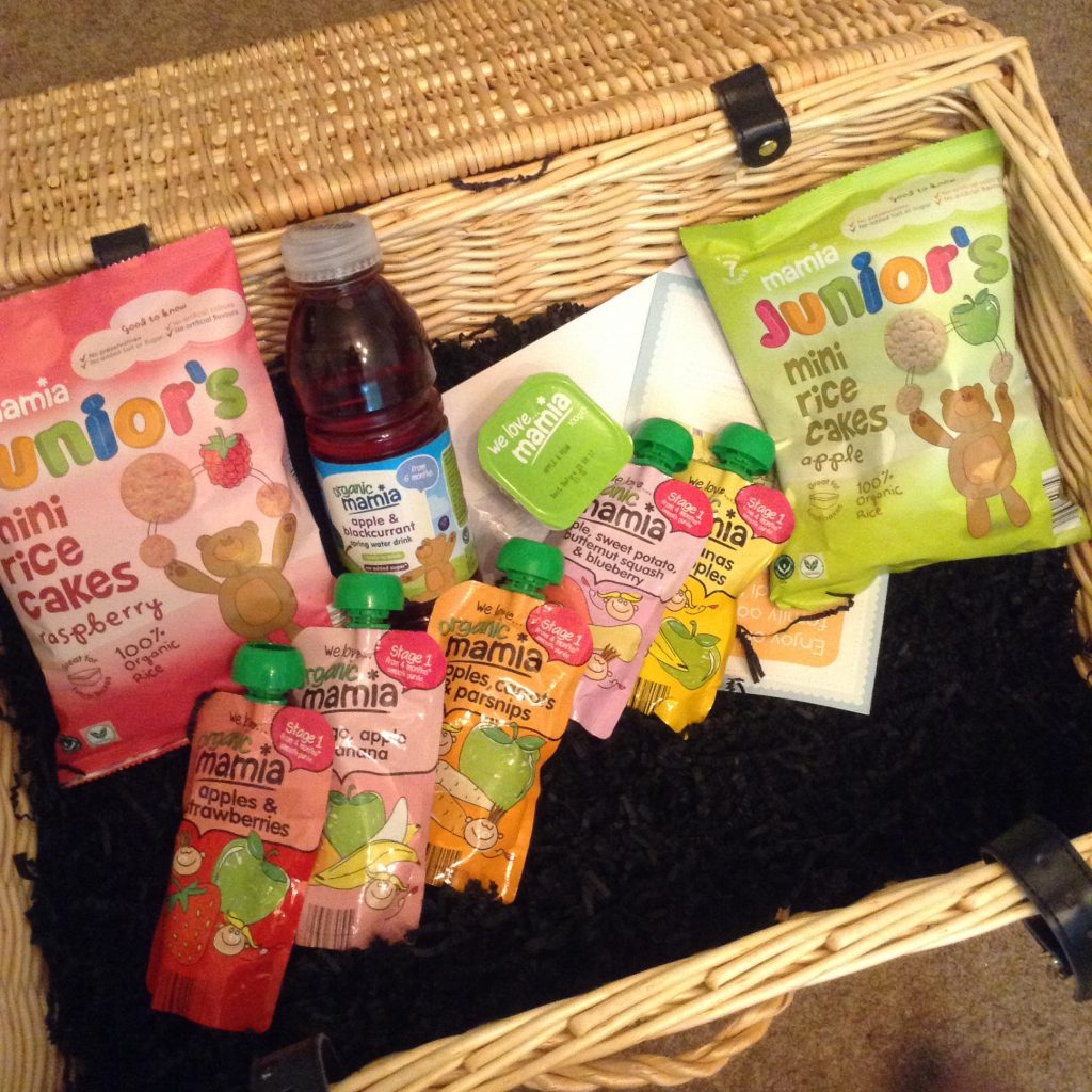 #MamiaDaysOut hamper, a large wicker basket filled with Mamia blackcurrant spring water, fruit puree pouches and rice cakes
