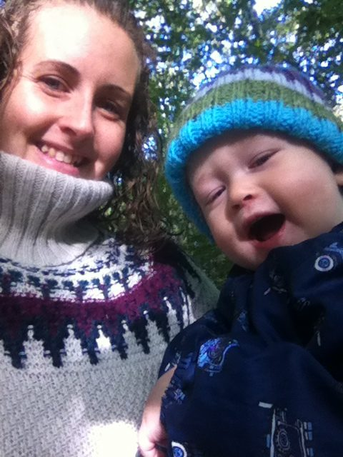 #mamiadaysout a photo of Lucas and I. Both of us looking into the camera, I am smiling with my curly hair down and wearing a cream roll neck jumper. Lucas is open mouthed with sparkly eyes wearing a stripy bobble hat
