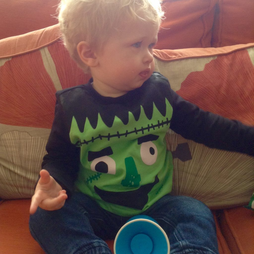 Halloween Lucas wearing a black top with a green monster on it