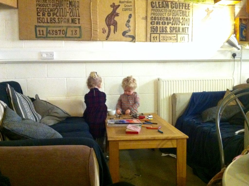 Ordinary moments, Lucas concentrating looking down at the table with a bowl of sugar sachets whilst his friend has her back to us