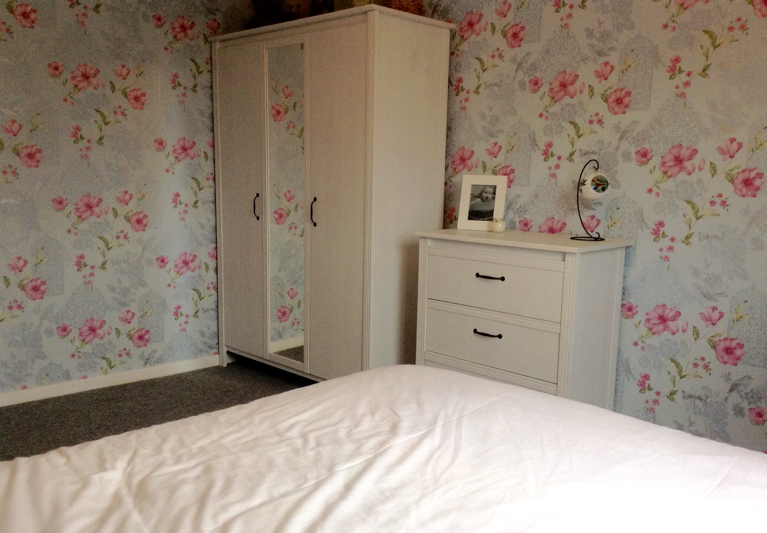 bedroom makeover, crown powder blue and cherry pink floral wallpaper with silver etched birds and glitter details, grey carpet, white ikea furniture