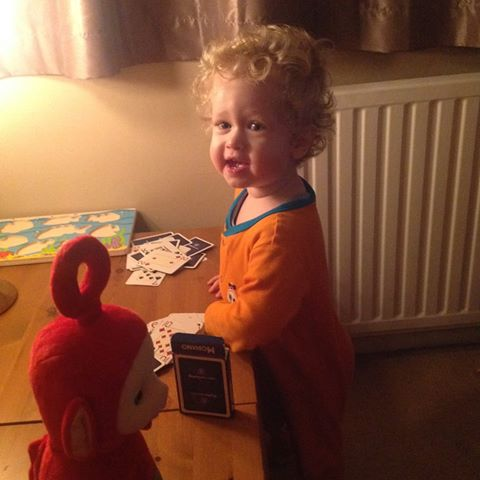 Christmas 2016 Living arrows lucas on new years eve wearing an orange sleepsuit, playing with cards
