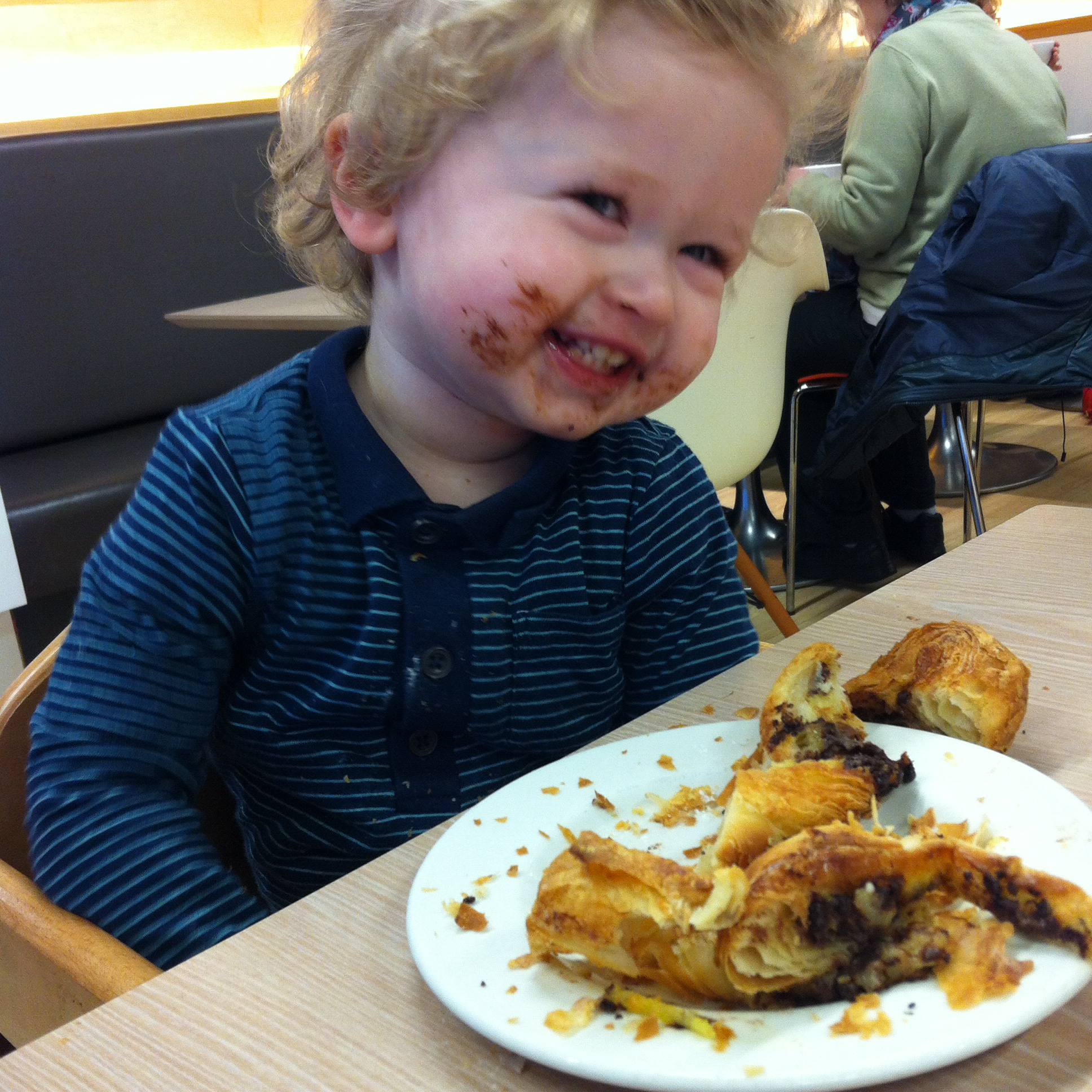 Happy days lucas smiling with chocolate all round his mouth and a chocolate twist broken up in front of him
