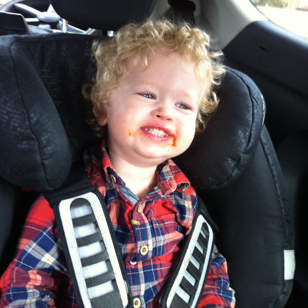 The ordinary moments. Lucas sat in his car seat with a huge teethy smile, tomato ketchup around his mouth. Red and blue checked shirt, blonde curly hair
