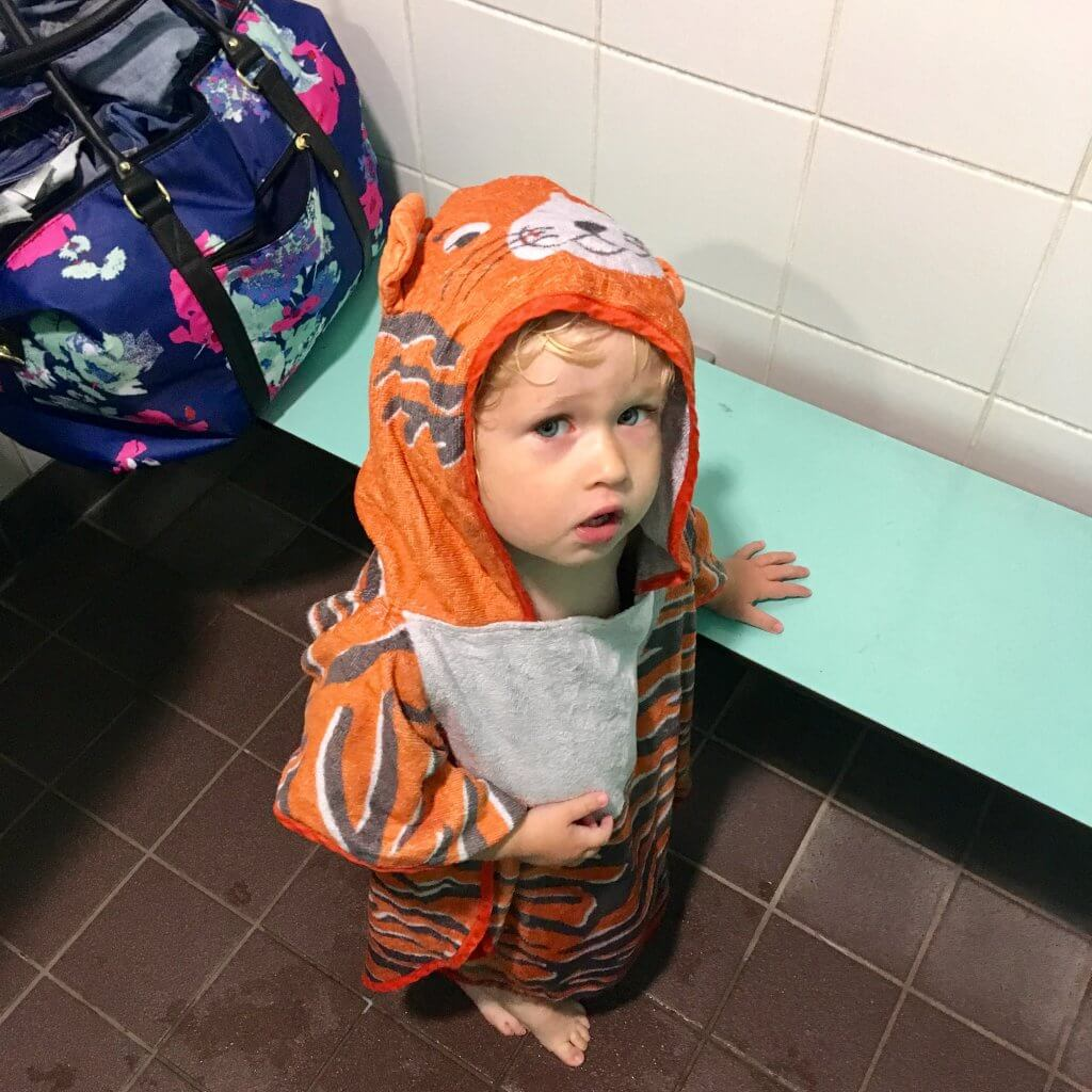 Ordinary moments. Lucas stood in a changing room wearing a tiger hooded towel looking at the camera