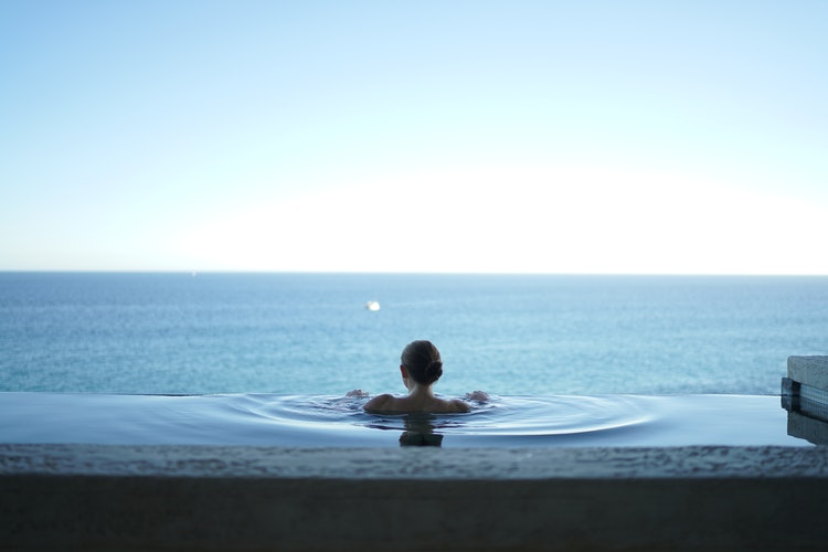 holiday whilst pregnant. A lady emerged into an infinity pool looking out over the ocean