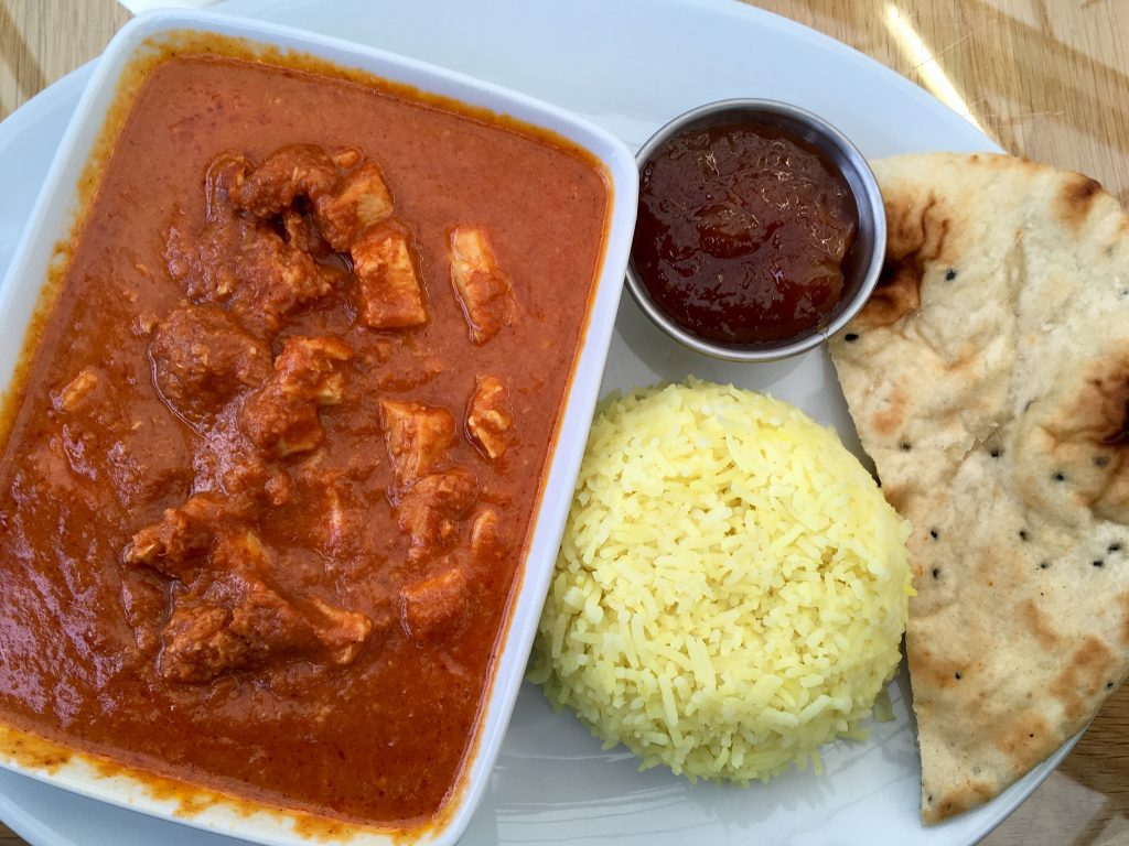 Birkacre garden centre restaurant, Coppull. A dish of chicken curry on a plate with a mound of rice beside it, a smaller dish of chutney and naan bread