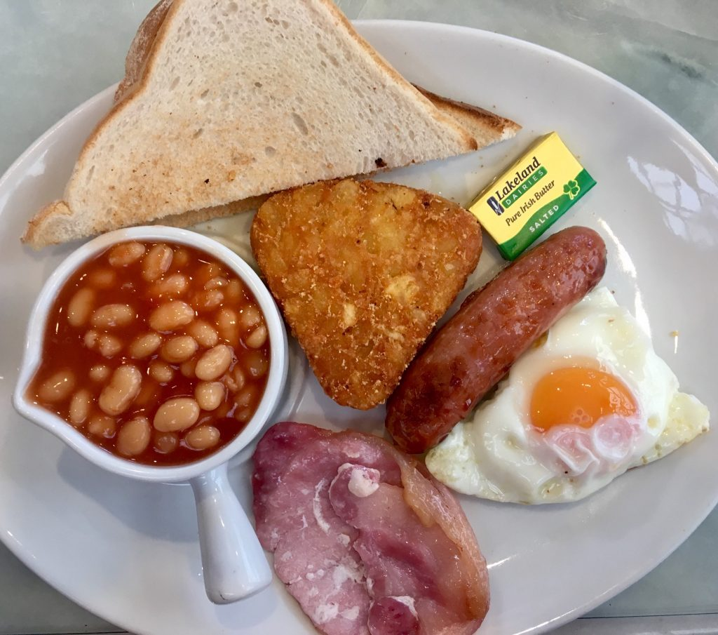 Birkacre garden centre restaurant, Coppull. A plate with a smaller pot of beans, a slice of bacon, toast cut in half, hash brown, sausage