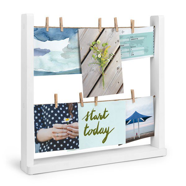 Valentines gift ideas. A white wooden frame with two lines of string and small wooden pegs hanging a selection of postcards