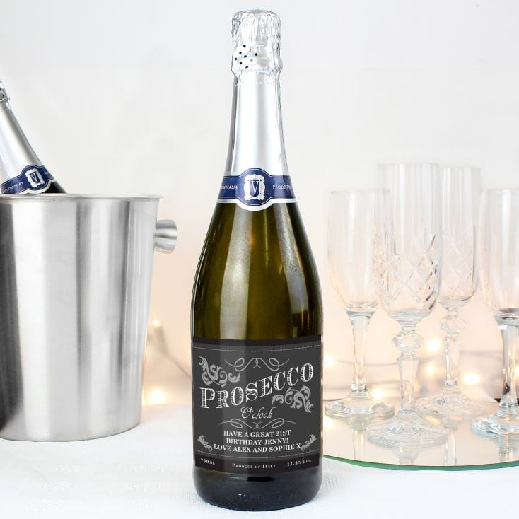Mothers Day gift ideas a bottle of prosecco with a personalised label, flute glasses and silver ice bucket in the background