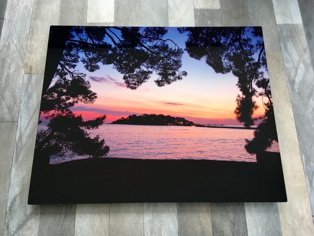HelloCanvas HD Metal review the front of the photo showing a pink sunset with a black island and palm trees