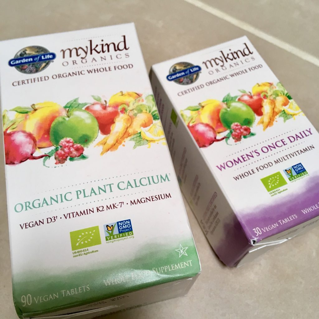 Feel healthier 2 boxes of mykind supplements. White packaging with colourful fruits and green text