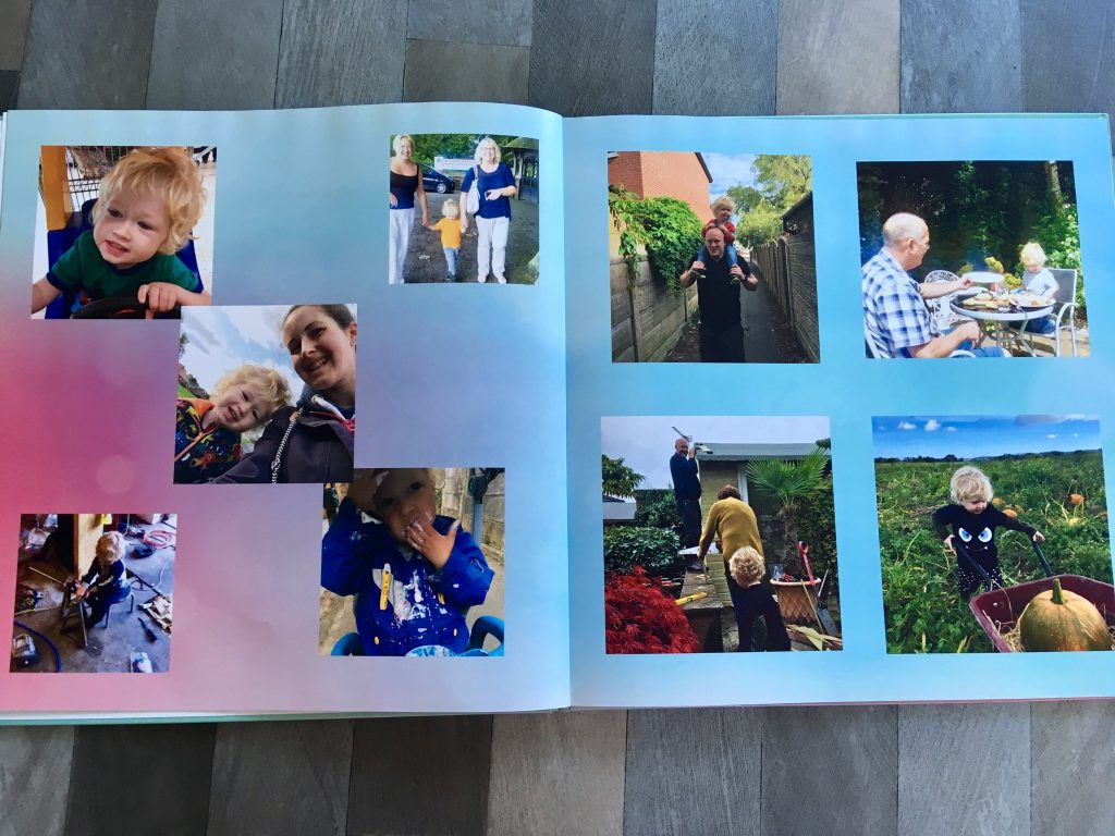My-Picture.co.uk photo book review. A photo of the book opens showing a pink and blue background and several small square boxes of photos