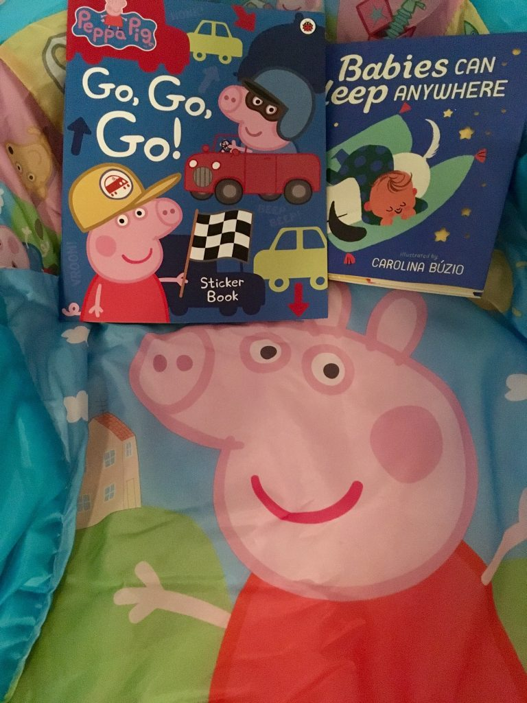 Bath, book, bed (and maybe a little creativity) A photo of Peppa Pig bedding with Peppa Pig sticker book and a sleepy bed time book