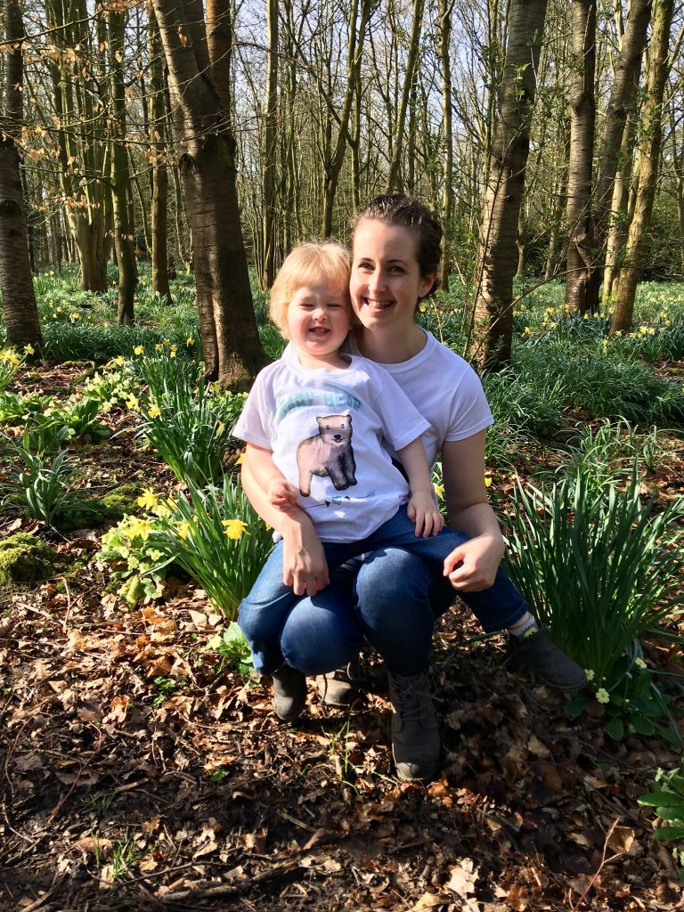 Mama Bear and Bear cub tshirts. We are knelt cuddling with our tshirts in. Surrounded by daffodils and trees