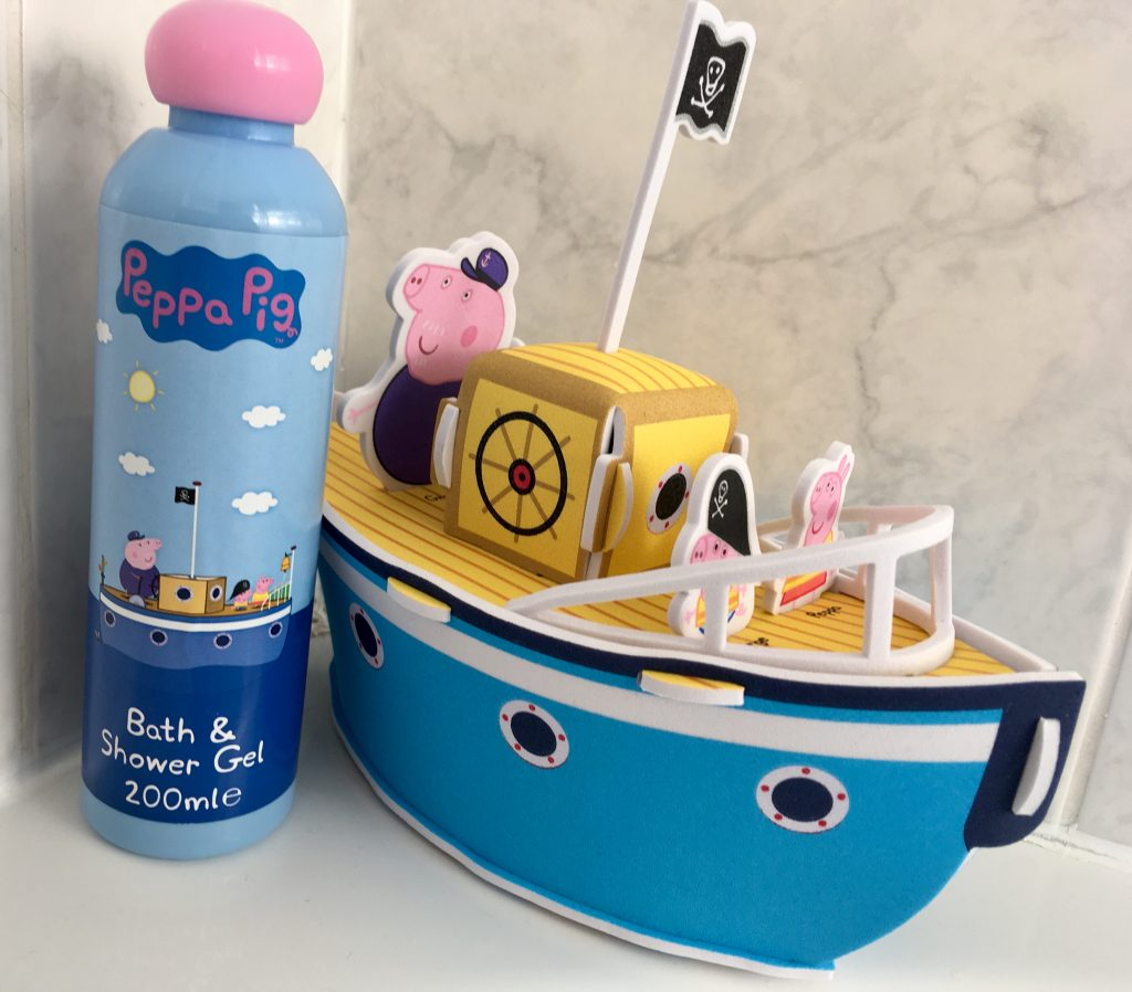 Bath, book, bed (and maybe a little creativity) A photo of a toy Peppa Pig boat and bottle of Peppa Pig bath and shower gel on white tile