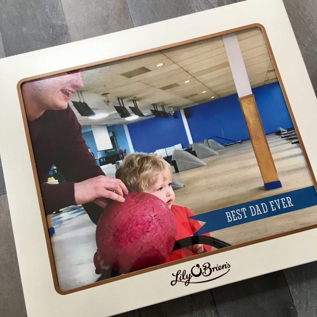 Father's Day gift ideas a photo of lily O'Brien's white chocolate box with a photo of Lucas and his Dad on the box playing bowling