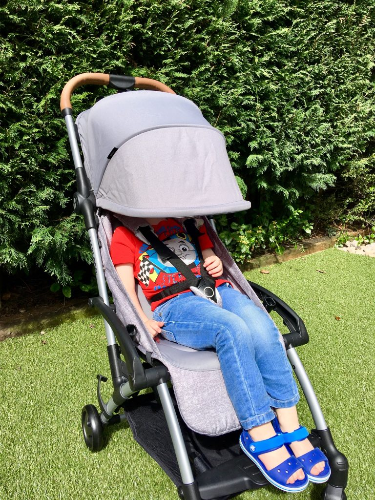 Maxi-Cosi Laika review Lucas is sat in the pram, the canopy is covering his face