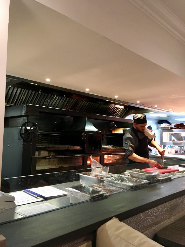 Blue Smoke on the Bay, Windermere. A photo of the open kitchen with the chef preparing food