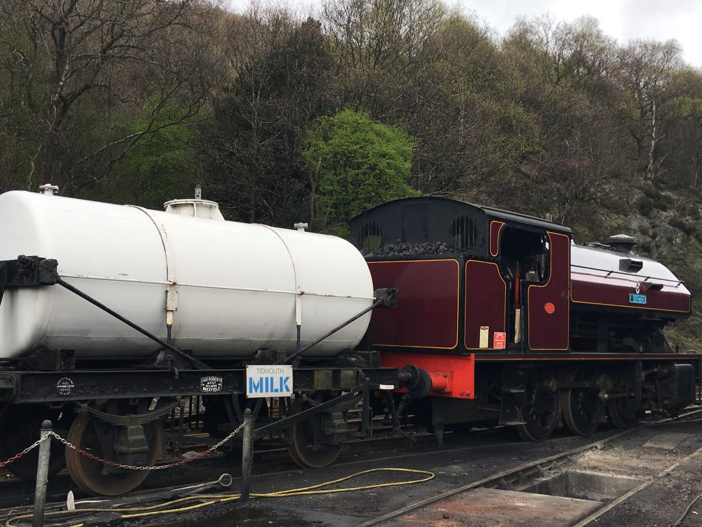 Lakeside and Haverthwaite Railway review A burgundy engine and a white milk truck trailor