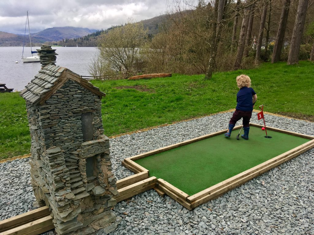 Brockhole on Windermere review Lucas playing crazy golf with Lake Windermere begind him