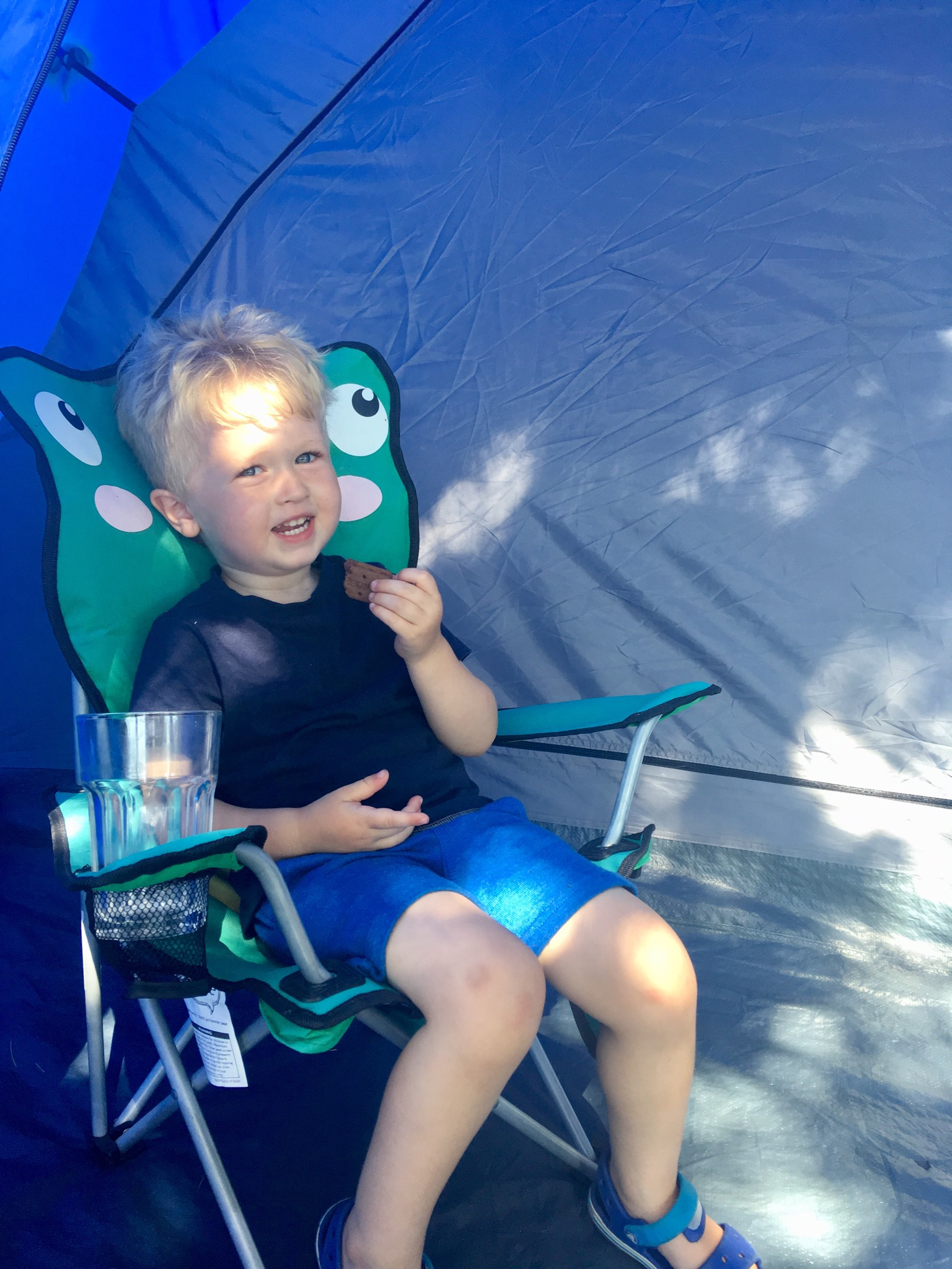 Wild Night Out 2018 Lucas is sat in a children's camping chair smiling at the camera