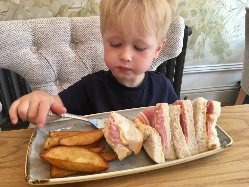 The Brasserie, Lancaster review. Lucas looking down at his ham sandwich and chips