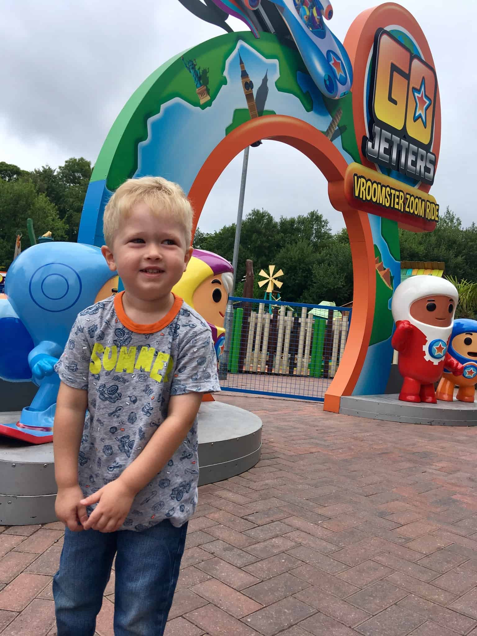 CBeebies Land, Alton Towers review. Lucas stood outside the octonauts ride entrance smiling