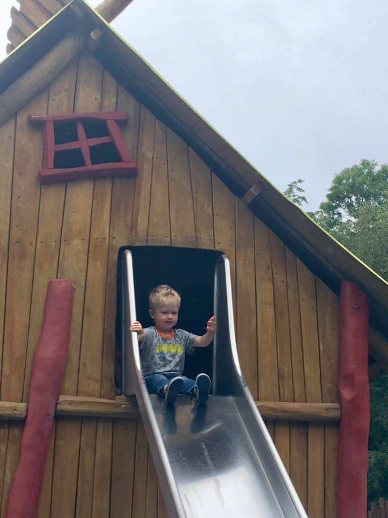 CBeebies Land, Alton Towers review. Lucas at the top of a slide that looks like it comes out of tree house