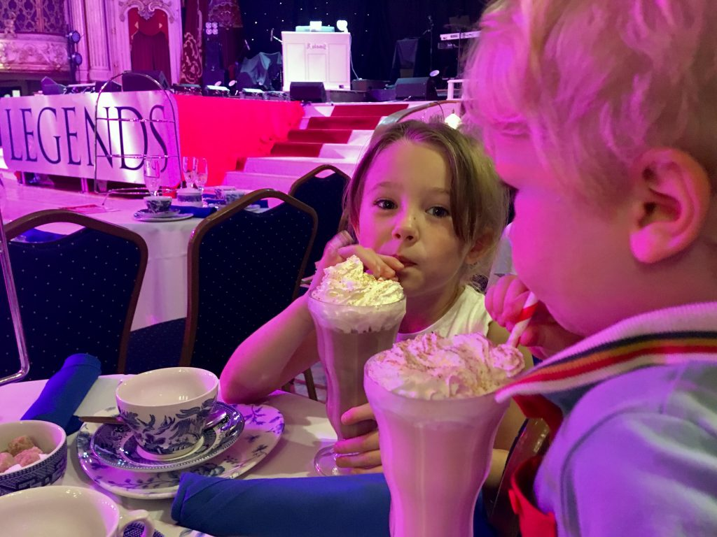 Afternoon Tea in Blackpool Tower Ballroom Lucas and Chanel drinking milkshakes