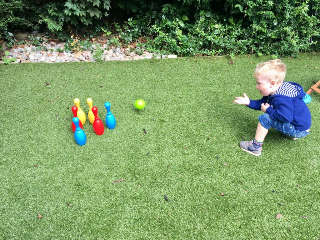 Celebrating outdoor play, every day Lucas crouching down playing Bowles