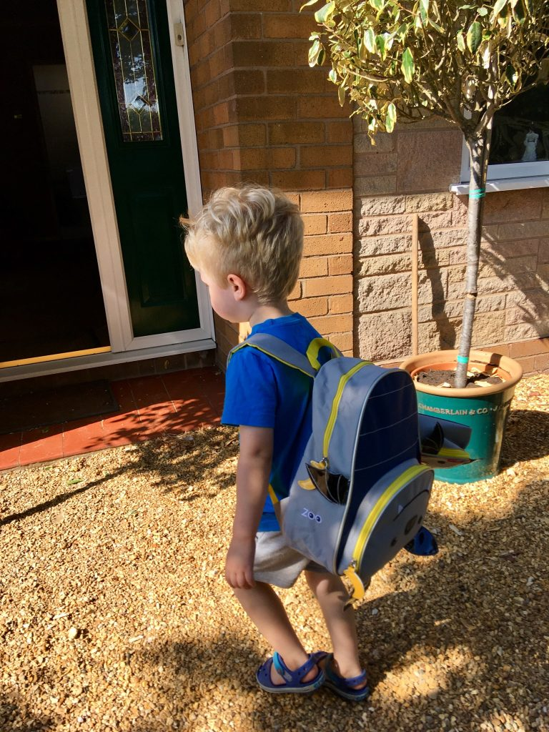 Skip Hop bags review Lucas walking away with the backpack on