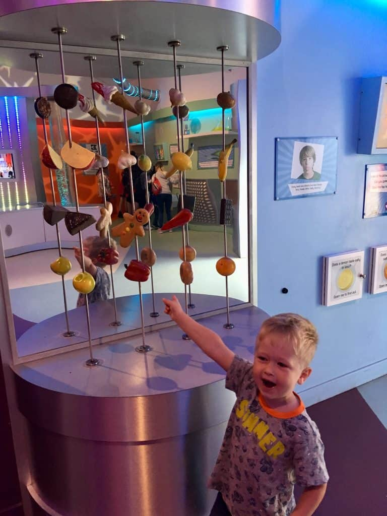 CBeebies Land, Alton Towers review. Lucas standing and pointing at toy food in Nina's lab