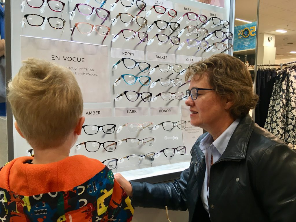 Marks and Spencer's Opticians my mum and luvas looking at a selection of glasses on display