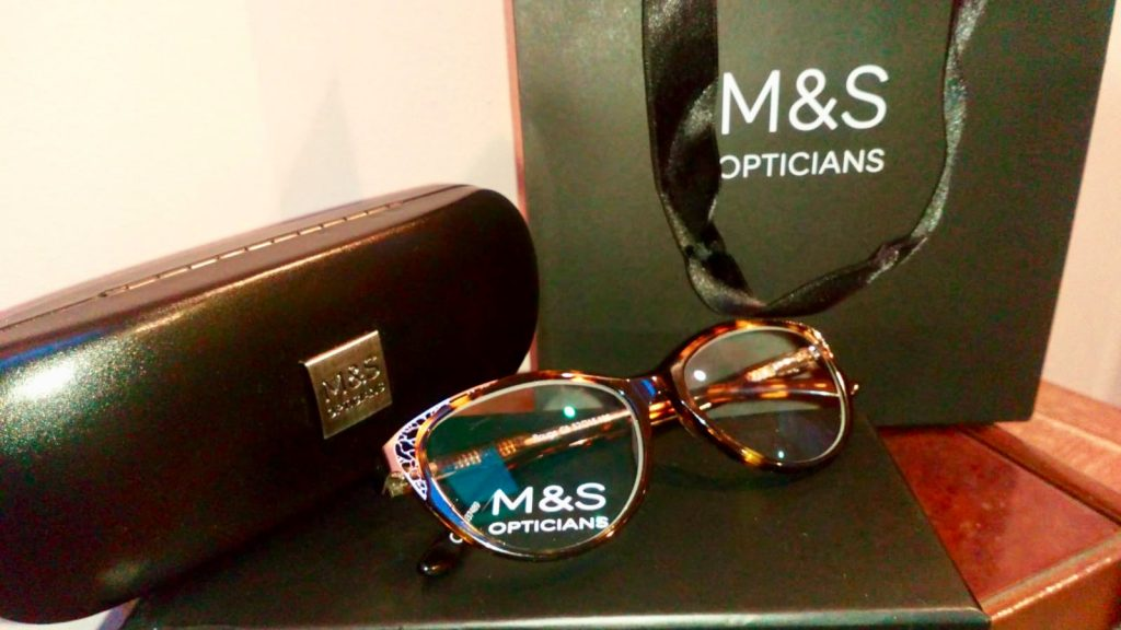 Marks and Spencer's Opticians brown and gold glasses with a branded black case and bag