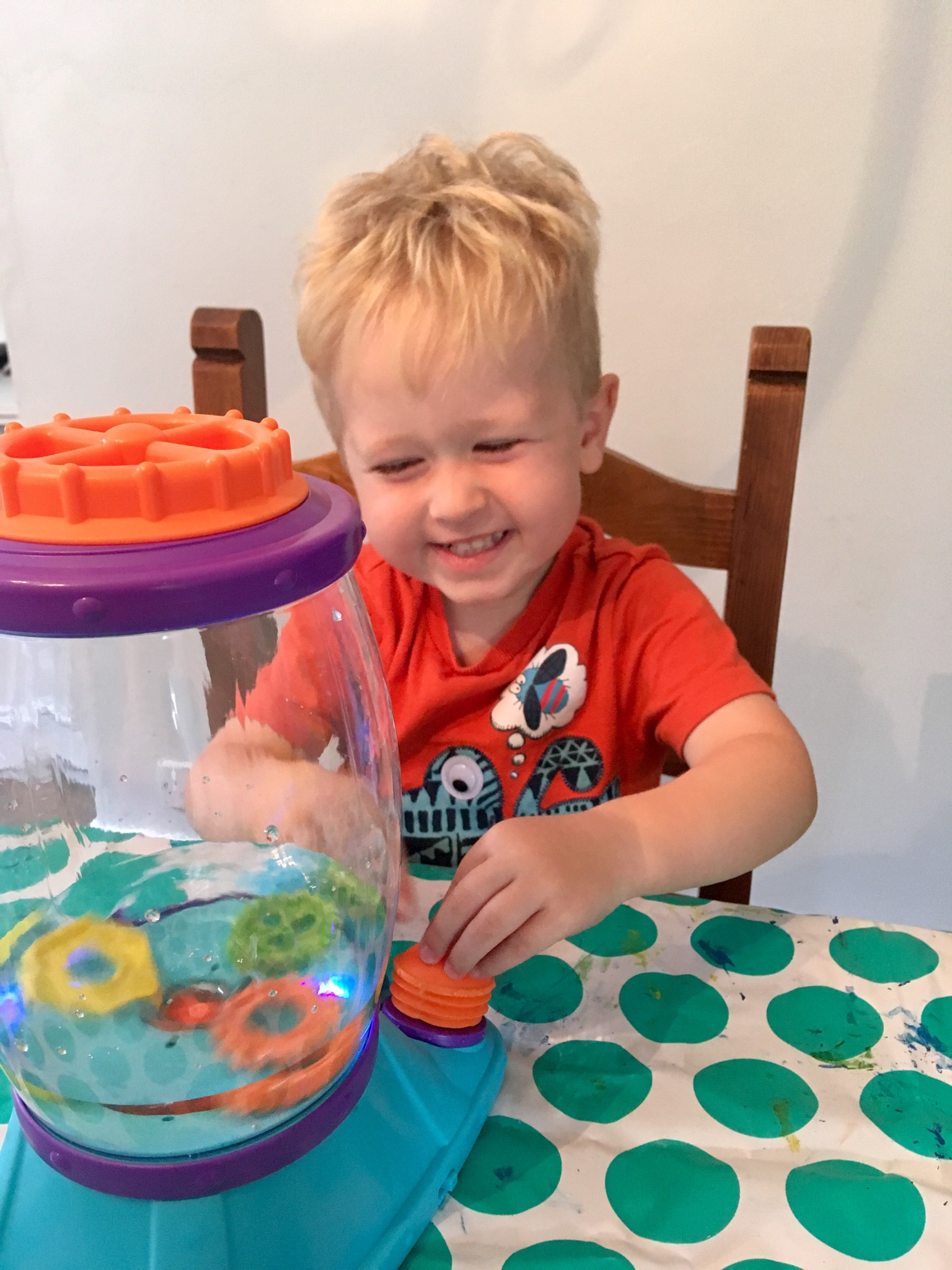 Little Tikes STEM Jr review Lucas sat at table with the tornado pressing the pump