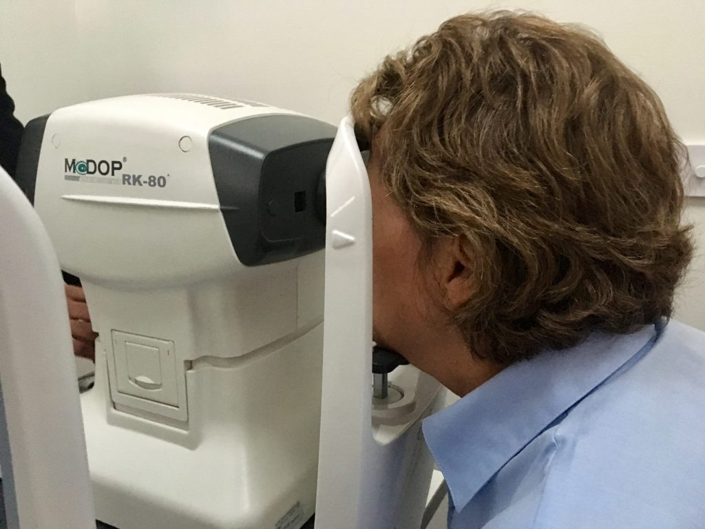 Marks and Spencer's Opticians Mum looking into one of the test machines